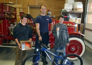 Pictured from left to right is: Linden Elliott, Fire Fighter Jeremy Bertrand and Keenan Harris.